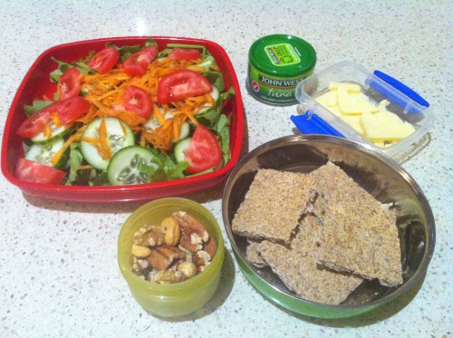 A salad (lettuce, tomato, carrot, cucumber) with flavoured tuna, plus ryvitas and cheese, and mixed nuts.