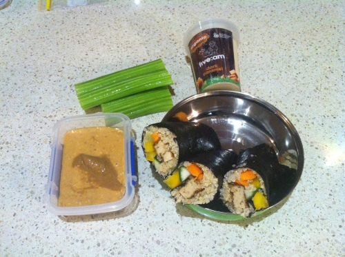 Quinoa sushi, with tofu, carrot, cucumber and capscium, plus peanut butter & tahini with celery sticks, and a 5:AM yoghurt